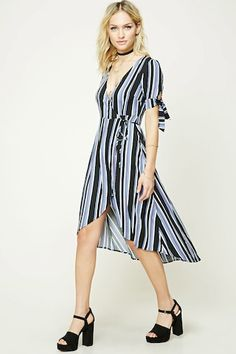 A woven midi dress featuring a wrap front, surplice neckline, striped pattern, self-tie short sleeves, and a high-low hem.