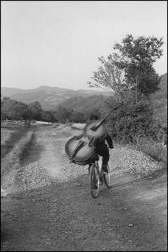 Bass player on the road Belgrade-Kraljevo, to play at a village festival near Rudnick, © Henri Cartier Bresson/Magnum Photos