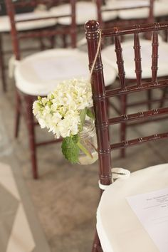 Like this arrangement idea for the mason jar flowers hanging off the ceremony chairs