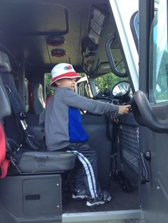 """Zachy """"drives"""" the fire engine."""
