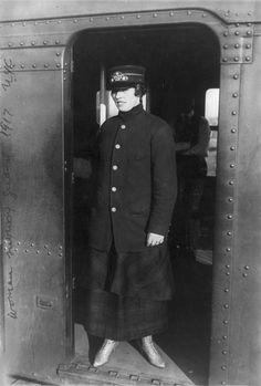 New York City, woman subway worker standing in subway doorway, New York, photograph, 1917.