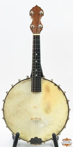 "A simple four string mandolin-banjo by the famous Vega Co. of Boston, a few years after they had acquired the Fairbanks company. Original 10-1/8"" rim, small mahogany neck. Original hardware intact including friction tuners, tailpiece. Currently set-up like a mandolin. Included in the sale is a period tenor banjo case, in which the small Style K ""comes up short"" to say the least..."
