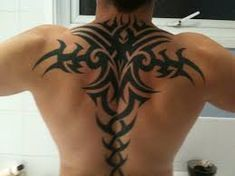 these tribal tattoos are nice because they are a contrast between the natural skin and the artwork - clean looking