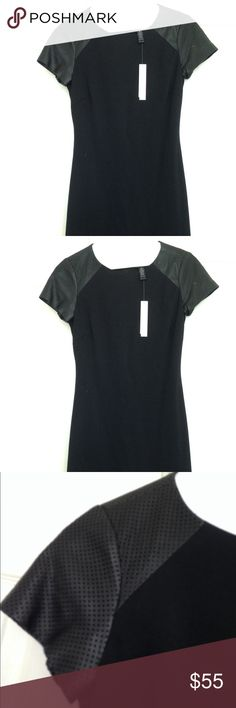 Aqua black dress with perforated genuine leather Aqua black dress with perforated genuine leather short sleeves..fully lined ..Open to offers :-) bundle items in my closet to save on shipping and extra discounts Aqua Dresses