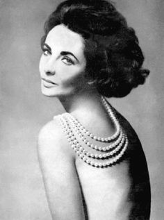 richard avedon photo of Liz Taylor wearing a creation of Balmain and Cartier jewels ...