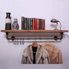 Solid timber shelf with an industrial iron gas pipe rail. Complete with black steel butchers hooks. - with a single central rail. 92 cm - with a 2 section central rail. - with a 3 section central rail. Industrial Clothes Rail, Vintage Industrial Furniture, Vintage Home Decor, Vintage Shelf, Industrial Bedroom, Vintage Design, Retro Design, Clothes Rail With Shelves, Chandeliers