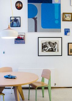 The Melbourne apartment of architect Rodney Eggleston and his partner Anne-Laure Cavigneaux. Coco Pendant Mini by Kate Stokes of Coco Flip,Table and chairs by Jean Prouvé – Vitra re-edition, two small square paintings of boats and silos by Mike Nicholls, large blue painting by Mark Howson, scraper board etching of three nymphs by Rodney's grandfather Roy Hodgkinson. Photos - Sean Fennessy , Production – Lucy Feagins / The Design Files.