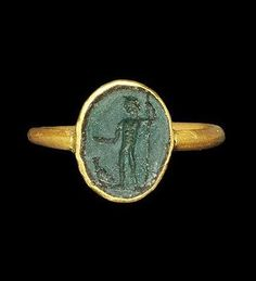 Roman Gold Ring with Jasper Intaglio of Jupiter 1st-2nd century AD. A round-section gold hoop with elliptical bezel enclosing a green jasper intaglio of a standing figure of Jupiter with wreath, staff, and eagle at his feet.