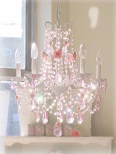 Shabby chic pink crystal chandelier.  idk re; pink