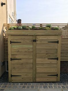 A bespoke Bluum Garden Store with living green roof area. Hand made from pressure treated, smooth planed timber. This garden tool & furniture storage solution features a planter roof, lockable doors, plenty of storage and makes an excellent addition to this contemporary courtyard garden in Bristol.
