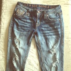 Rock revival straight leg jeans Light acid wash distressed style holes on both legs gold stitching slightly metallic size 27 style Betty. Bought from buckle lightly used, straight leg denim Rock Revival Jeans Straight Leg