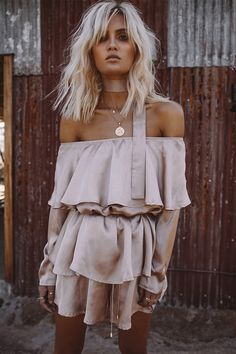 The super cute Vanilla Tie Playsuit is made from a lightweight crepe-feel fabric in a french vanilla hue. It features a cross-over tie up neckline and elasticated waistband. Complete the look with a hat and tan flats. By Morrisday.