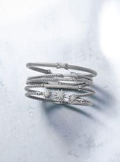 Stacks of silver cuffs | David Yurman