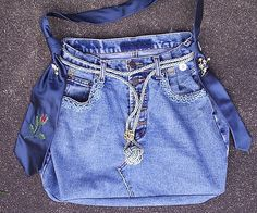 Up-cycled jeans bag with drapery cord closure and silk tie strap.