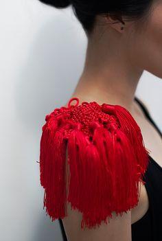 Yuni Kim Lang ,handmade jewelry design. Shoulder Piece: Big Red Knots, 2013. Photo by Matjaz Tancic