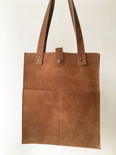 Brown leather shopper bag with two slip pockets on the front. Can be held by the handles or worn over the shoulder. Shopper Bag, Brown Leather, Reusable Tote Bags, Van, Pocket, Collection, Vans, Tan Leather, Vans Outfit
