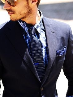 The coordination of blues is great. There's something about that tie clip…