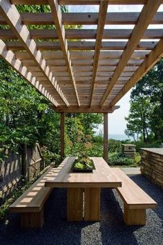 Room for everyone under the pergola in this lovely dining area. by audra