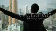 Man opens curtains on the view Hong Kong HD Stock Footage Clip. Medium shot. 2013-01-23.