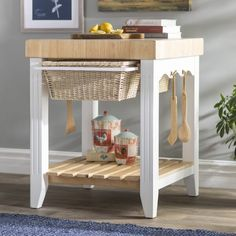 Add a traditional feel to your kitchen, and added storage and work space with this kitchen island. It is crafted from solid acacia and rubberwood, in a two-tone finish, and features a butcher block tabletop, two basket drawers, two hooks, and a slatted bottom shelf, for stowing away all your extra kitchen essentials. Wood tongs and wood spoons are also included with this piece. The butcher block top can be conditioned with food grade oil, and washed with a damp cloth. Assembly is required upon Steel Furniture, Cheap Furniture, Unique Furniture, Dining Furniture, Furniture Cleaning, Furniture Websites, Furniture Movers, Furniture Outlet, Furniture Companies
