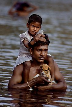 Sri Lanka / Steve McCurry // #man #child #dog