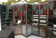 use bifold doors with ledges to display jewlery ~ If they were mine I would distress paint them
