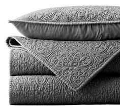 Vintage-washed Belgian linen shams and quilt in Fog, $49 to $279, at Restoration Hardware.  quilting feat....