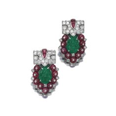 Pair of ruby, emerald and diamond clips, Cartier, 1930s Each clip set with a carved emerald within a border of ruby beads and single-cut diamonds, the surmount pavé-set with circular-cut diamonds and calibré-cut rubies, each signed Cartier and numbered.