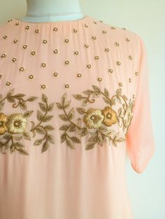 Get Set Pretty in this pastel Blush Shaded Handwork Tunic. The tunic features a . Embroidery Suits Punjabi, Zardosi Embroidery, Embroidery On Kurtis, Kurti Embroidery Design, Hand Embroidery Dress, Embroidery Neck Designs, Embroidery Fashion, Beaded Embroidery, Embroidery Fabric