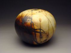 "saggar fired porcelain sphere, 11"" x 12"""
