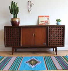 Mid-century modern walnut stereo console made by Zenith circa 1964.
