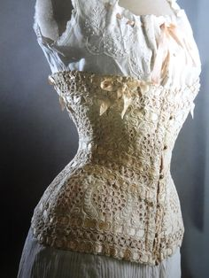 """Corset 1900.  Loose translation from German e-book: """"silhoutte of a corset with eyelet embroidery,satin ribbons and hemstitching.time:1900. It looks very light and simple because of the pulled thread work but its a very rigid construction. The cown under it, protect the skin from the hard boning. -Lingerie,collection rolf heyne"""""""