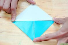 How to Make an Origami Sailboat. Interested in adding a sailboat decoration to your desk, or perhaps creating a gift tag? This article sets out how to make an origami sailboat which you can use in many different ways. Sailboat Decor, Sailboat Living, Origami Sailboat, Origami Paper, Plastic Cutting Board, Gift Tags, How To Make, Pictures, Gifts