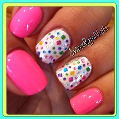 Colorful gemstones on white nail art design
