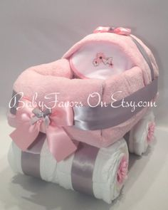 Great gift for a new baby or beautiful centerpiece for Baby Shower. This beautiful Carriage Diaper Cake is built from 54 Diapers size 1 1 Fleece Blanket 1 Receiving Blanket 1 Bib. Cakes can be made for boy, girl, or we can use your favorite color. This cake is approximately 14 Long, 10 Wide by 12 tall. Each cake is served in tulle tied with a premium ribbon... Please let us know which one you like, or if you want custom colors. Bibs on some carriages may vary, so if you want a specifi...