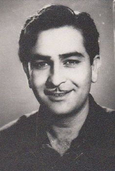 The son of actor Prithviraj Kapoor, Raj Kapoor started his career as a clapper boy but bagged his first film role at the age of eleven. In 1948, he set up his own studio and made his first feature film, Aag, which would become the first of his many early successes, including Barsaat in 1949, Awara in 1951, and Shree 420 in 1955. Bollywood Cinema, Bollywood Stars, National Film Awards, Vintage Bollywood, Indian Artist, Indian Movies, Indian Celebrities, Telugu Movies, Classic Films
