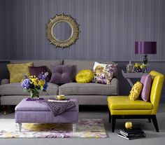 "I reallly like the rug.   How to Incorporate Mardi Gras Inspired Interior Decor Into Your Space . . .  — Deux Mardi Gras Colors — purple and gold (GarrisonHullinger.com) (""Vertical gray and purple wallpaper pair perfectly with the mix matched pillows and flower patterned rug for a comfortable yet feminine room."")"