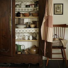 Kitchen country style storage Turn an antique armoire or wardrobe into a rustic kitchen storage cupboard or collection display to bring a heart-warming look to your home. Rustic Kitchen, Country Kitchen, Vintage Kitchen, Kitchen Dining, Kitchen Larder, Vintage Hutch, Dining Room, Kitchen Ideas, China Hutch Decor