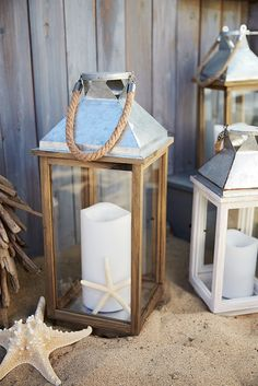 """Named for the Hebrew phrase meaning """"public square of the town,"""" Pier 1's Rehoboth Lantern makes quite a centerpiece. Handcrafted of pine, it's topped with a rust-resistant iron roof and natural rope handle. Simply place your favorite pillar inside, and you're ready to light up the night."""