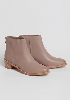 Beautifully crafted, these leather ankle boots feature almond-shaped toes and stacked heels.