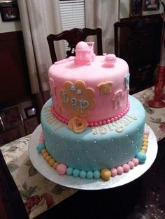 """Baby shower cake.  12"""" round on the bottom  and a 8"""" round on the top.  Each tier has four layers"""