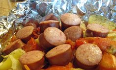 Campfire Bundles (peppers, carrots, cabbage, tomatoes, Polish sausage and seasonings) cooked in foil packets over the fire (or grill)