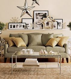 pictures & collection on ledge over sofa.