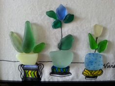 I made these flowers in pots with 100 percent authentic beach sea glass from Mendocino Ca. Find on Etsy.com/Beachensea
