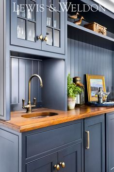 """A classic Cape Cod wet bar finished in Benjamin Moore """"Abyss"""" with hidden ice maker Home Wet Bar, Bars For Home, Kitchen And Bath, New Kitchen, Kitchen Ideas, Wet Bar Designs, Kitchen Cabinet Colors, Grand Homes, Custom Kitchens"""
