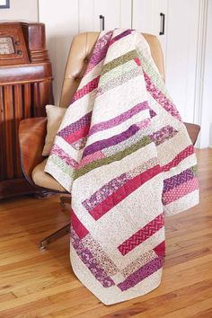 """Canal Street, by Stephanie Sheridan, is the perfect quick quilt. Looking for a weekend project or something that you can quilt in a day? This quilt uses 2-1/2"""" strips and is simple to assemble."""