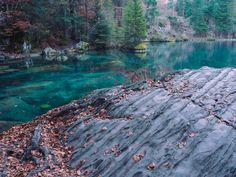 If you want to go to one the most beautiful places in Switzerland, you definitely have to visit the lake Blausee near Bern. The crisp air surrounded me and the leaves were rustling while I walked through the forest. Places In Switzerland, Most Beautiful, Beautiful Places, To Go, River, Blue, Outdoor, Outdoors, Outdoor Living
