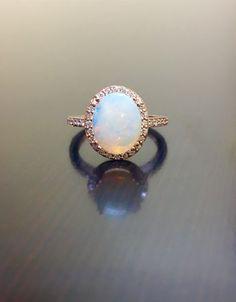 14K Rose Gold Halo Diamond Opal Engagement Ring - Rose Gold Opal Diamond Wedding Ring - Art Deco Rose Gold Opal Ring - Halo Diamond Ring by DeKaraDesigns on Etsy https://www.etsy.com/listing/260040572/14k-rose-gold-halo-diamond-opal