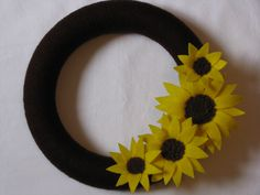 Sunflower Wreath - Yarn Wreath - Flower Wreath - Spring Wreath - Summer Wreath - Felt Flower Wreath - Felt Sunflower Yarn Wreath. $35.00, via Etsy.