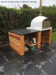 Shame it was wet, a bespoke made pizza oven on a solid wood base with a slate work top and slate flagstones on the ground from Ardosia.